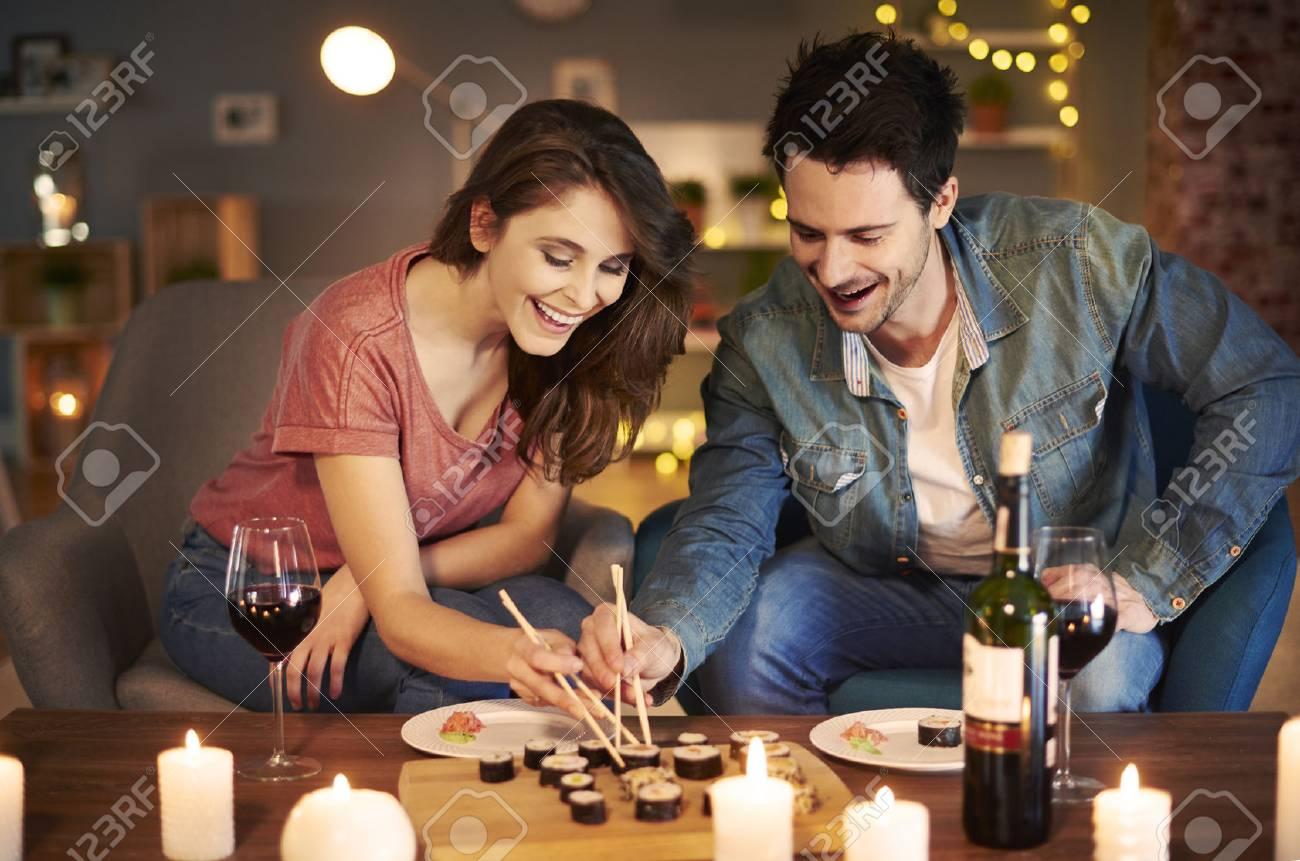 Boyfriend and girlfriend trying Asian food - 73107599