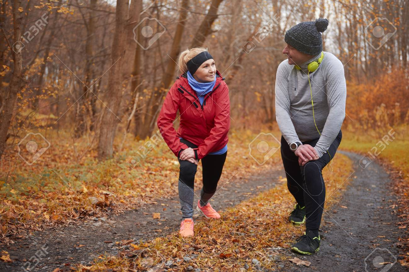 Active seniors training over autumn time - 82481721