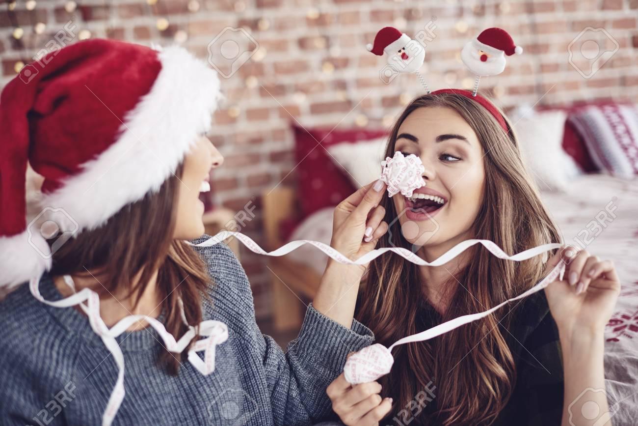 Female friends amusing each other - 87265142