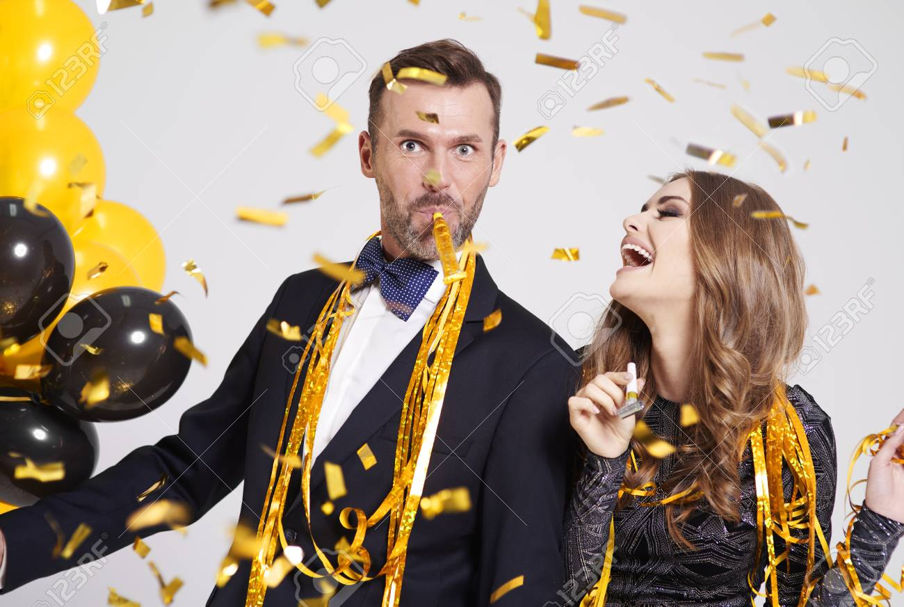 Couple with horn blower partying - 88749302