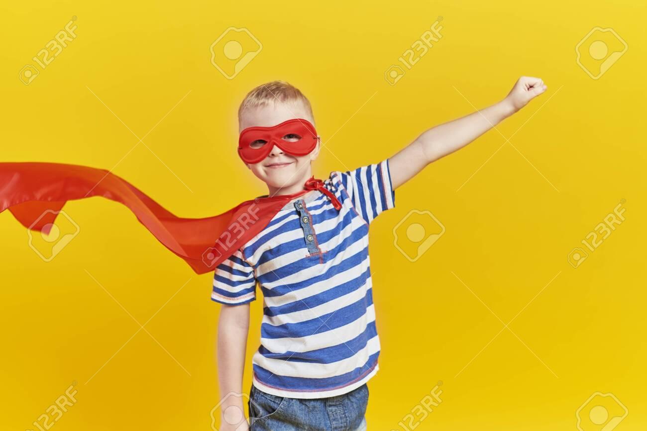 Portrait of playful boy in superhero costume - 132188928