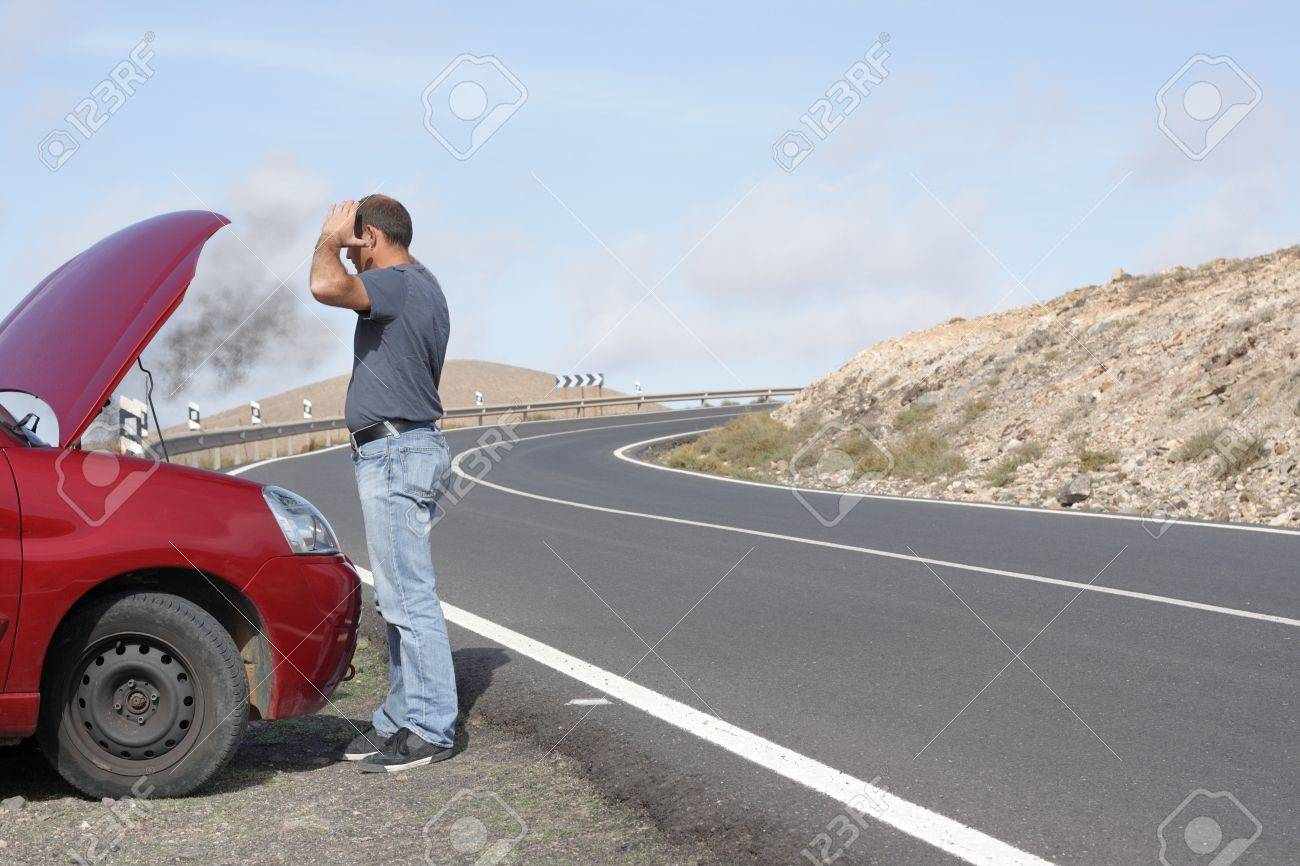 Car driver having a breakdown Stock Photo - 16011185