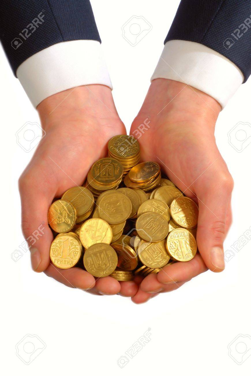 businessman holds in hands many gold coins on  white background,  close up Stock Photo - 874601