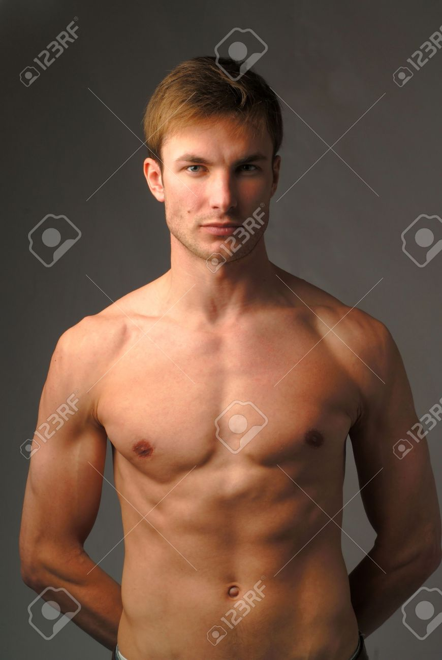 portrait young naked men which looks in chamber on dark background Stock  Photo - 1080059
