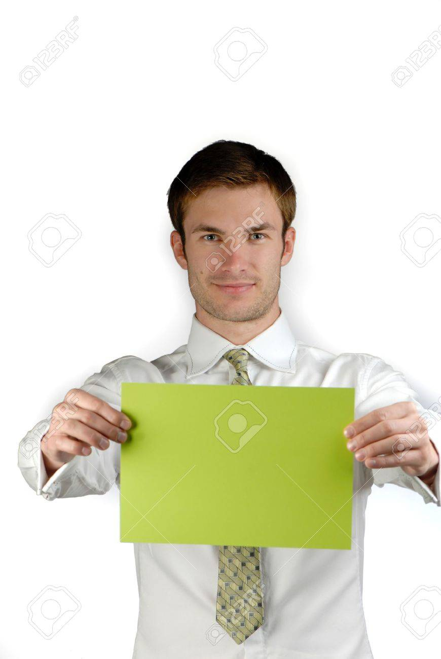 young businessman holds in hand  green sheet of  paper on  white background Stock Photo - 1929823