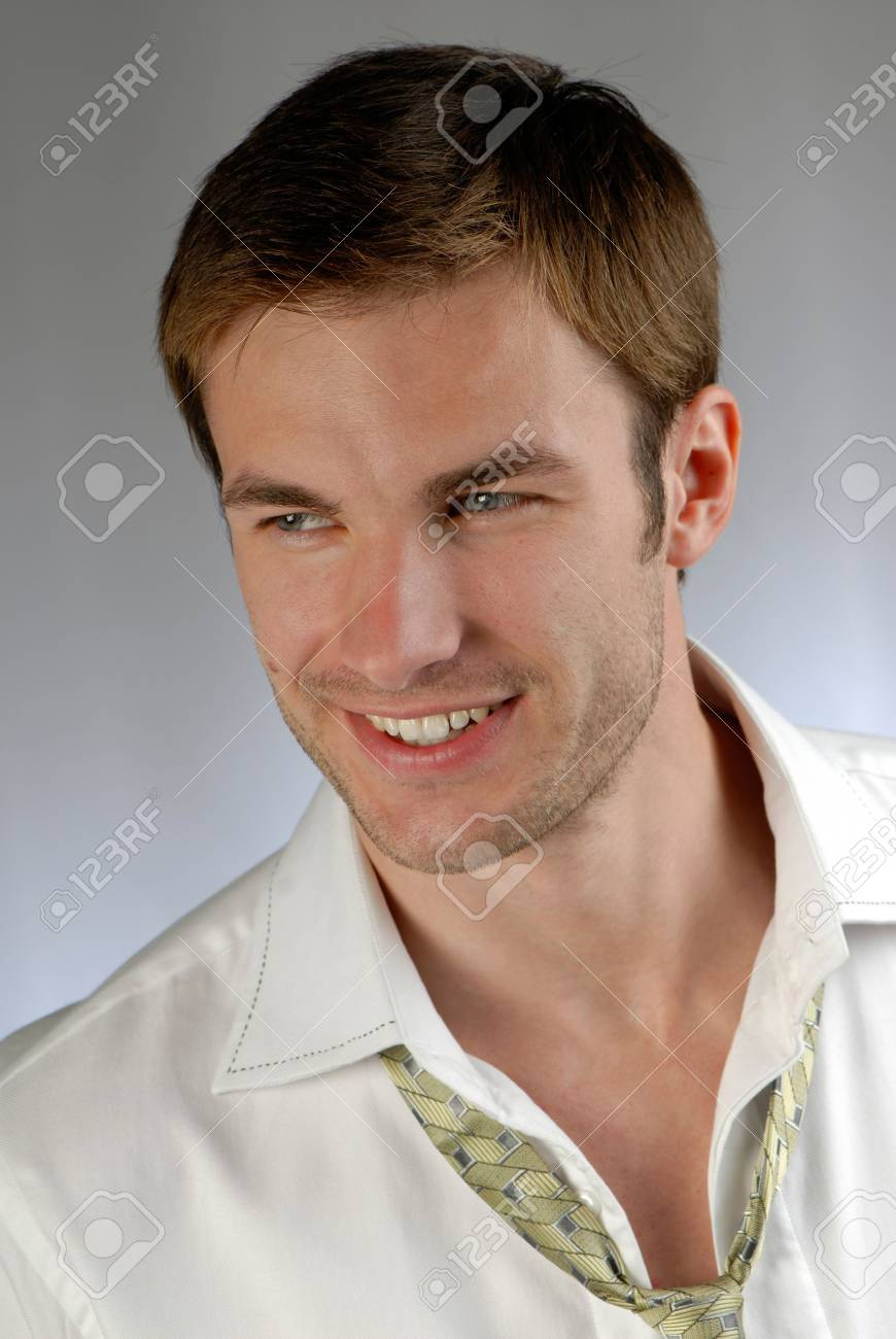 portrait of  cheerful young businessman in  shirt on  grey background Stock Photo - 2025577