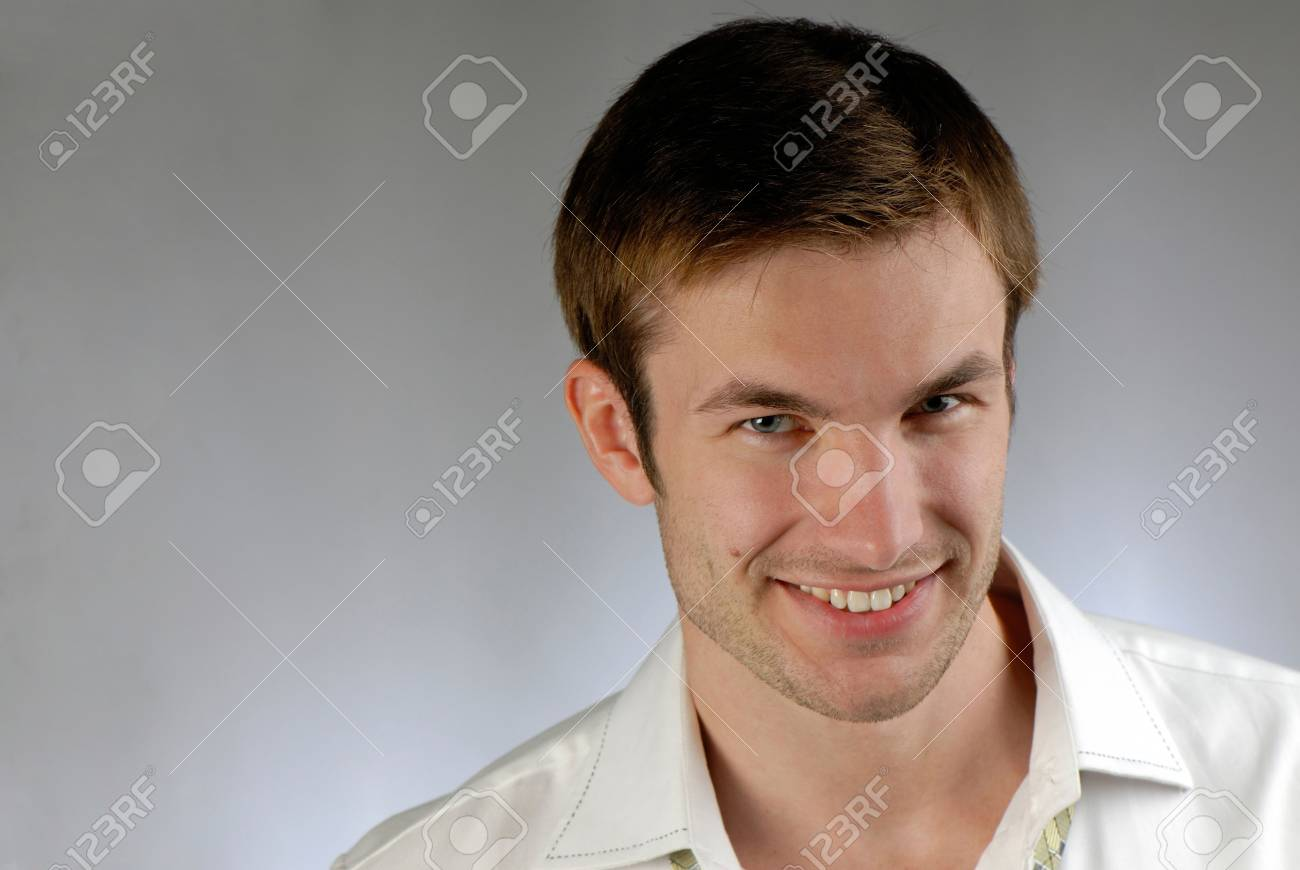 portrait of  cheerful young businessman in  shirt on  grey background Stock Photo - 2025515