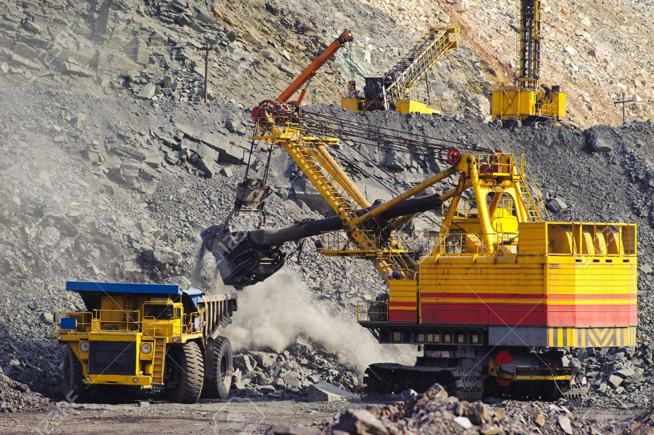 Loading and export of iron ore in career by open way by means of dredges and lorries Stock Photo - 7395328