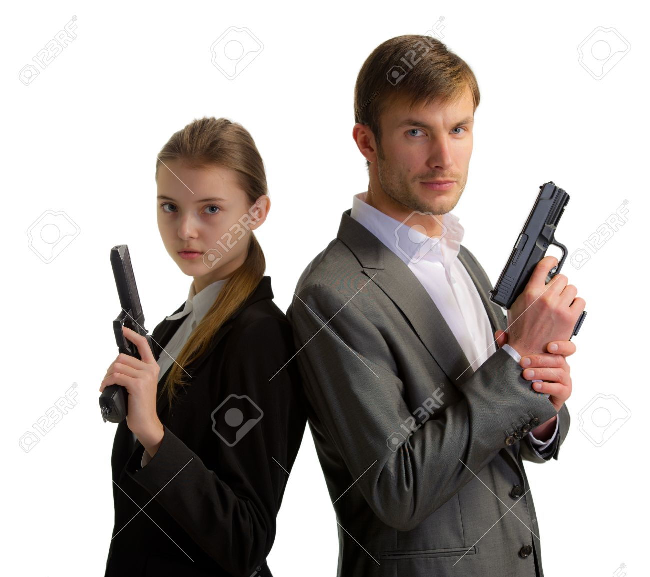 couple of nice bodyguards the man and the woman with guns in hands isolated on a white background Stock Photo - 18872622