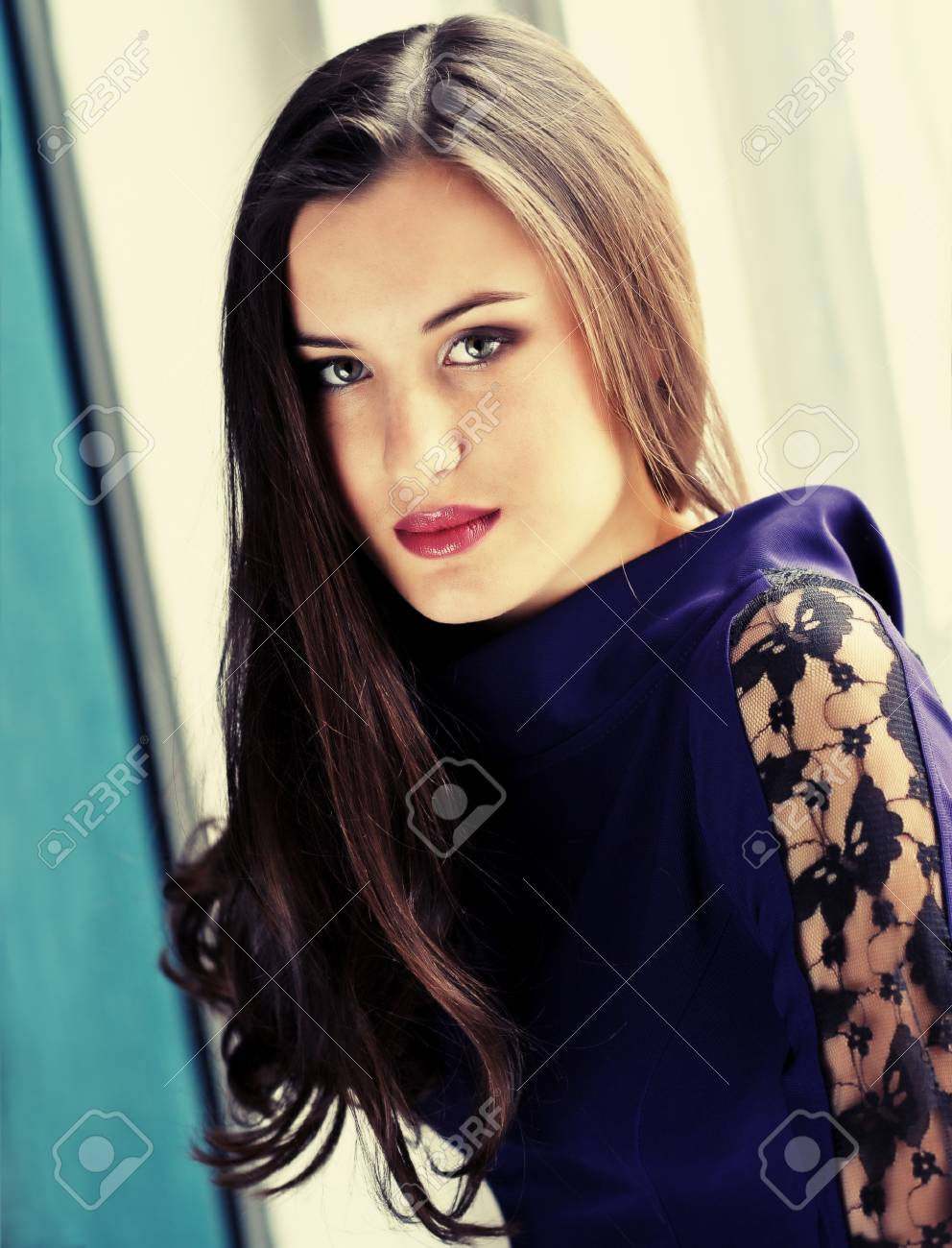 woman with her hair in a room on a dark background Stock Photo - 25590413