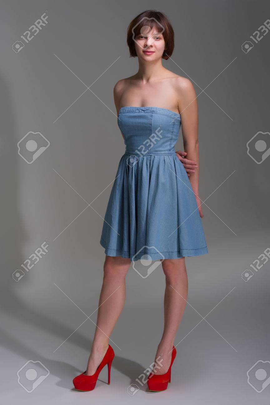 Cute Young Woman In Denim Dress And Red
