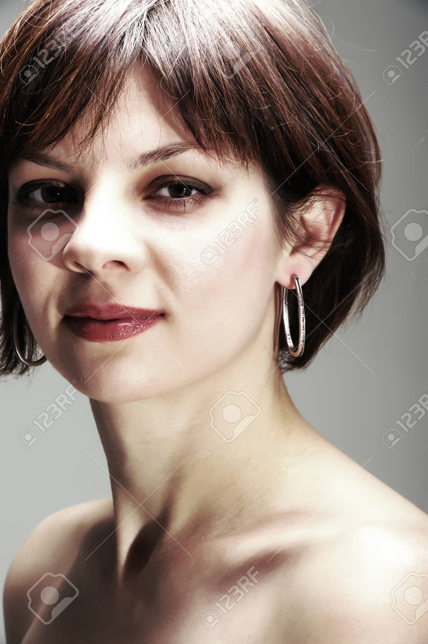 Portrait Of A Pretty Young Woman With Short Hair And Earrings Stock Photo Picture And Royalty Free Image Image 29042626