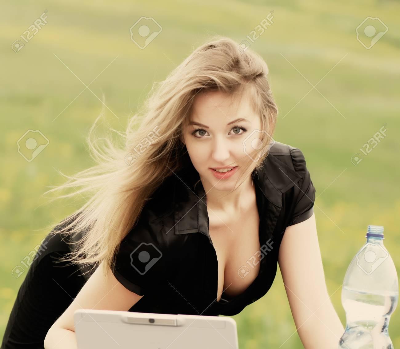 beautiful business woman drinking water maintenance used laptop, closeup Stock Photo - 30571871