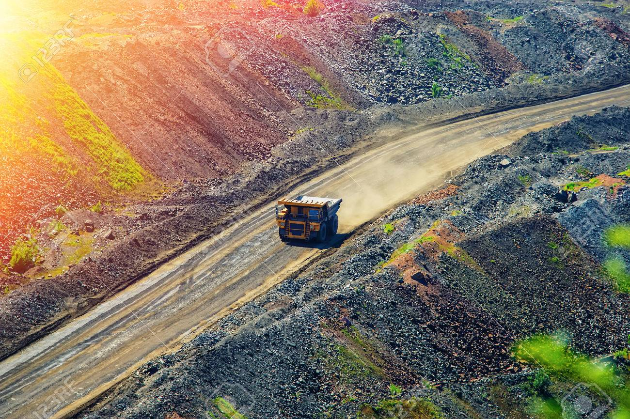 tipper and road for trucks in a pit of iron ore - 42994959
