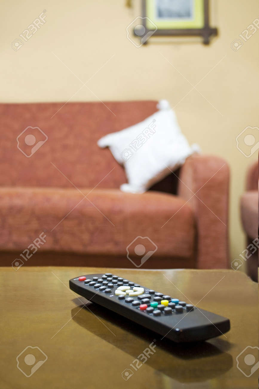 Lonely Remote Control On The Living-room Table, Emphasizing The ...