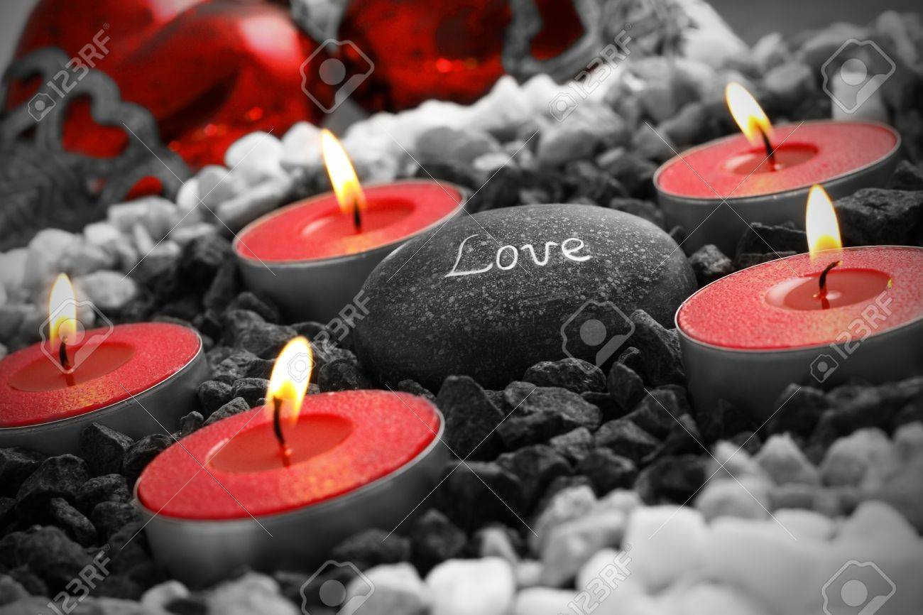 love stil live with hearts cabdles and a love stone. Stock Photo - 8669231