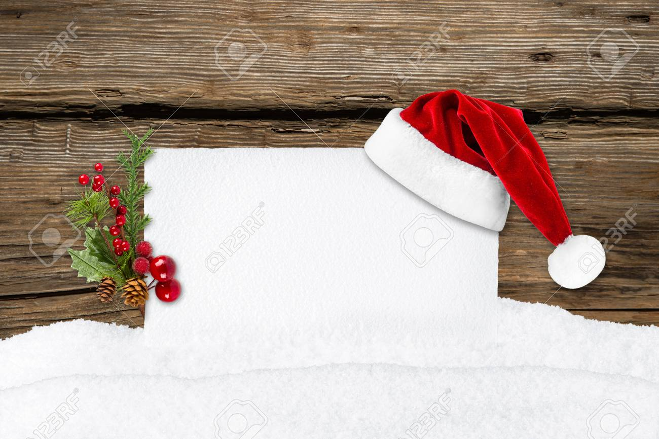 xmas card with santa hat in front of wooden background Stock Photo - 26055121