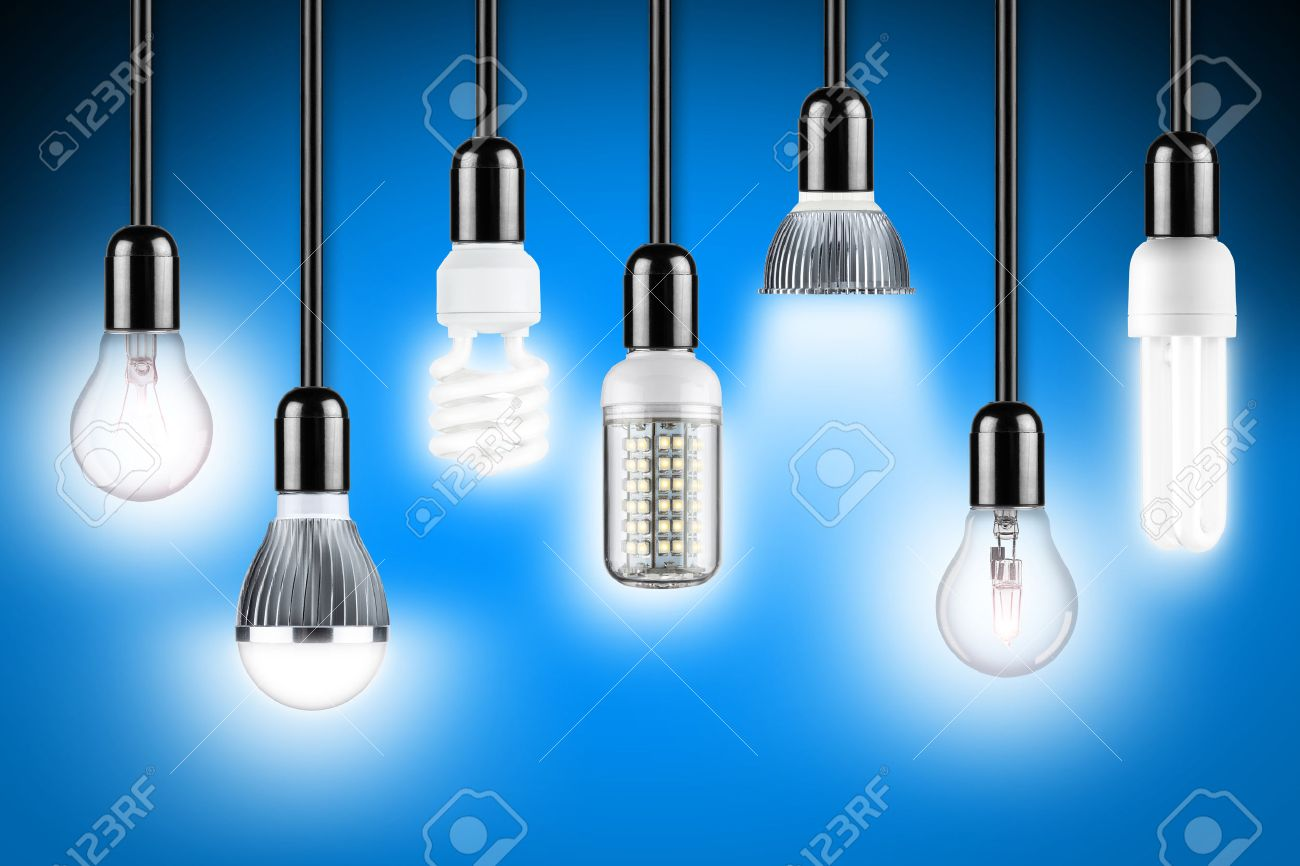 row of different types of glowing light bulbs stock photo picture