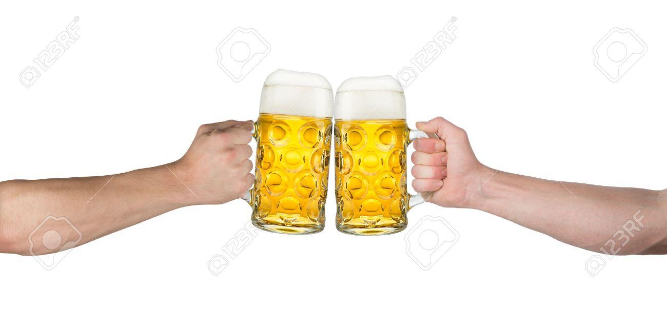 cheers hands holding up german beer mugs