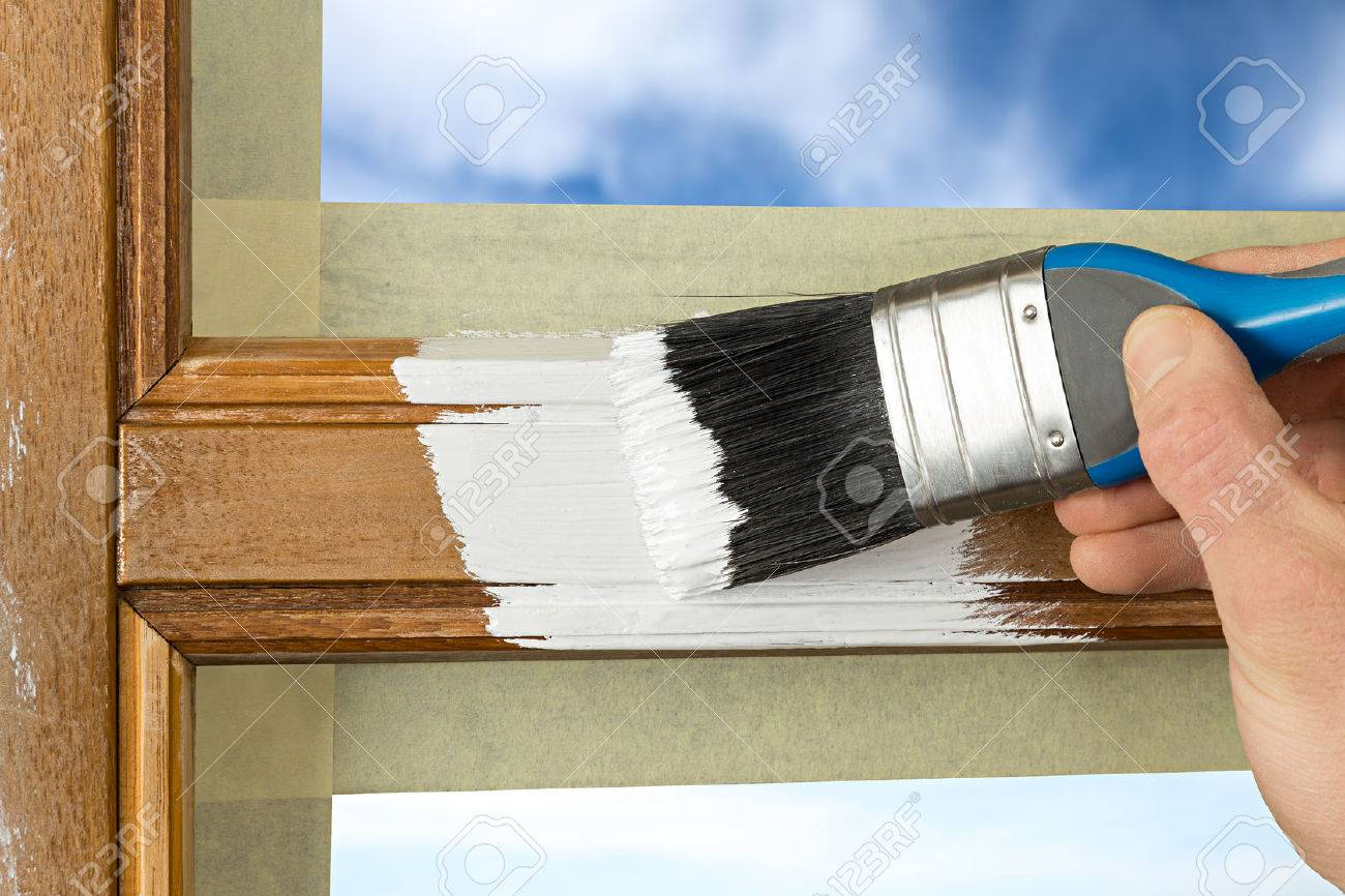 pinting a window frame with white color - 52022300