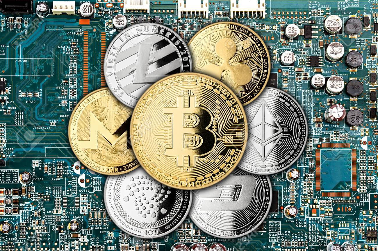 golden silver crypto currency coin on motherboard chip digital