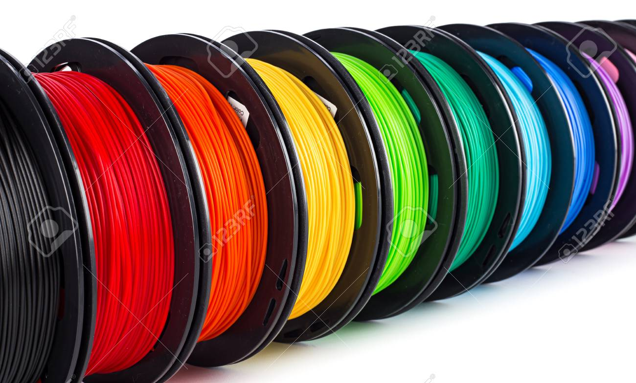 colorful bright wide panorama row of spool 3d printer pla abs filament plastic material isolated on white background - 121536568