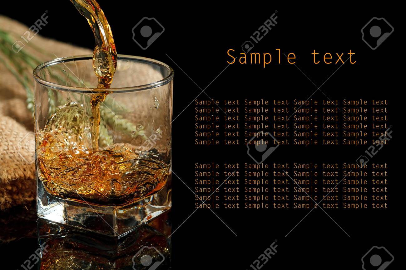 Whiskey glass and bottle on a black Stock Photo - 20244236