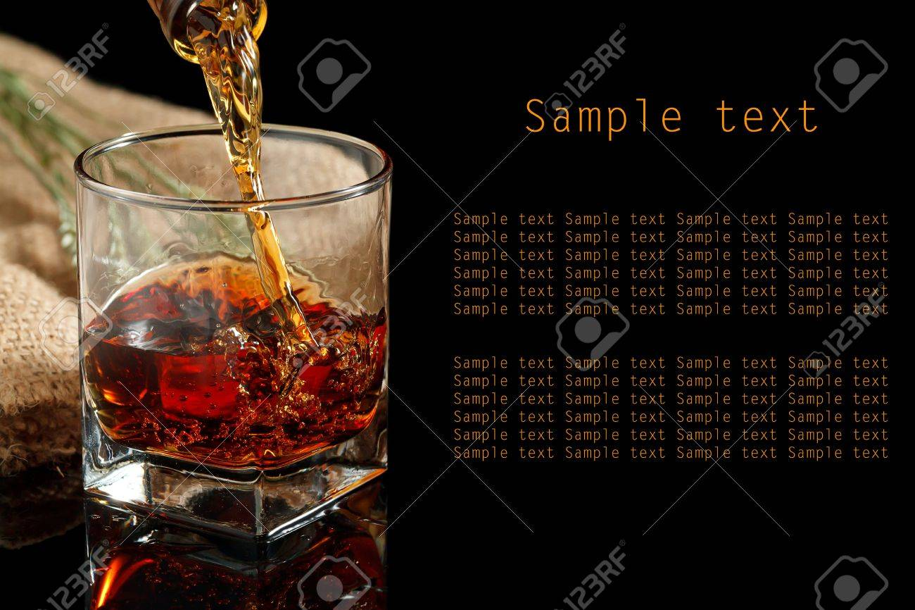 Whiskey glass and bottle on a black Stock Photo - 20244235