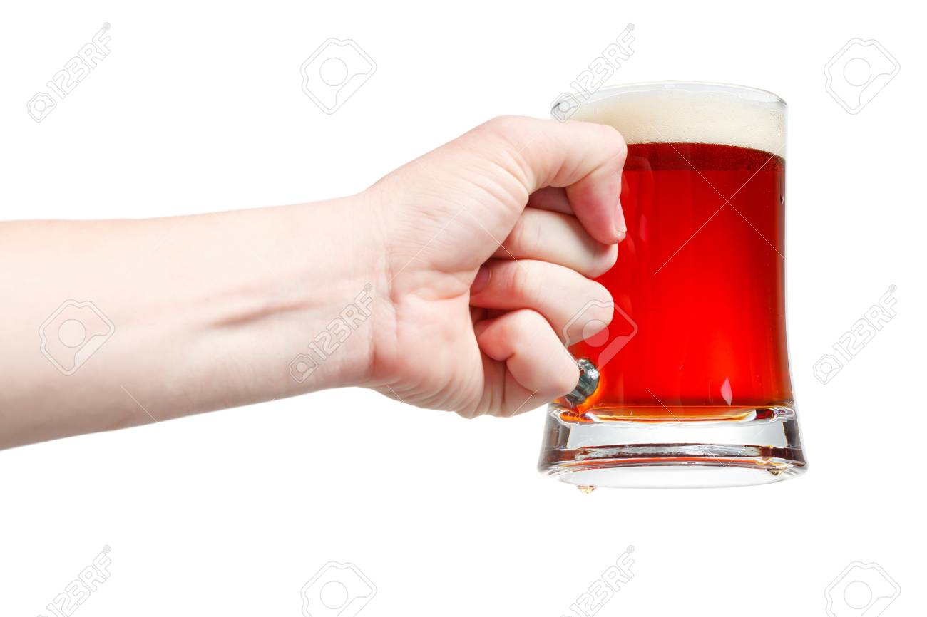 Closeup of a male hand holding up a glass of beer over a white background Stock Photo - 20903363