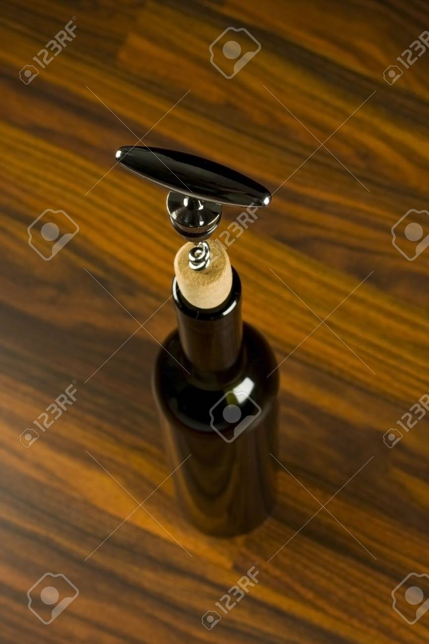 Opening a wine bottle with corkscrew Stock Photo - 7104439