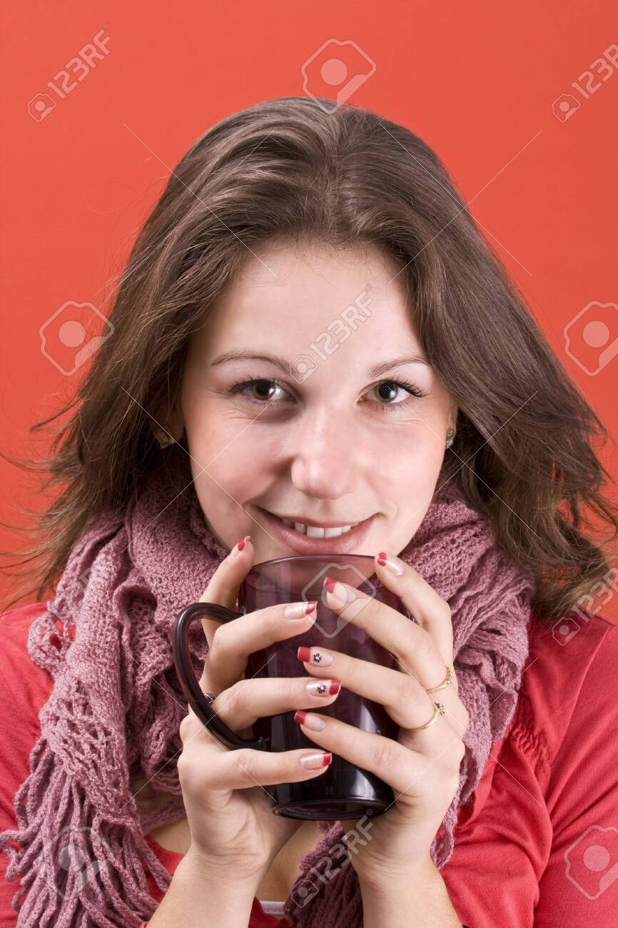 smiling woman with cup of hot-something Stock Photo - 8091750
