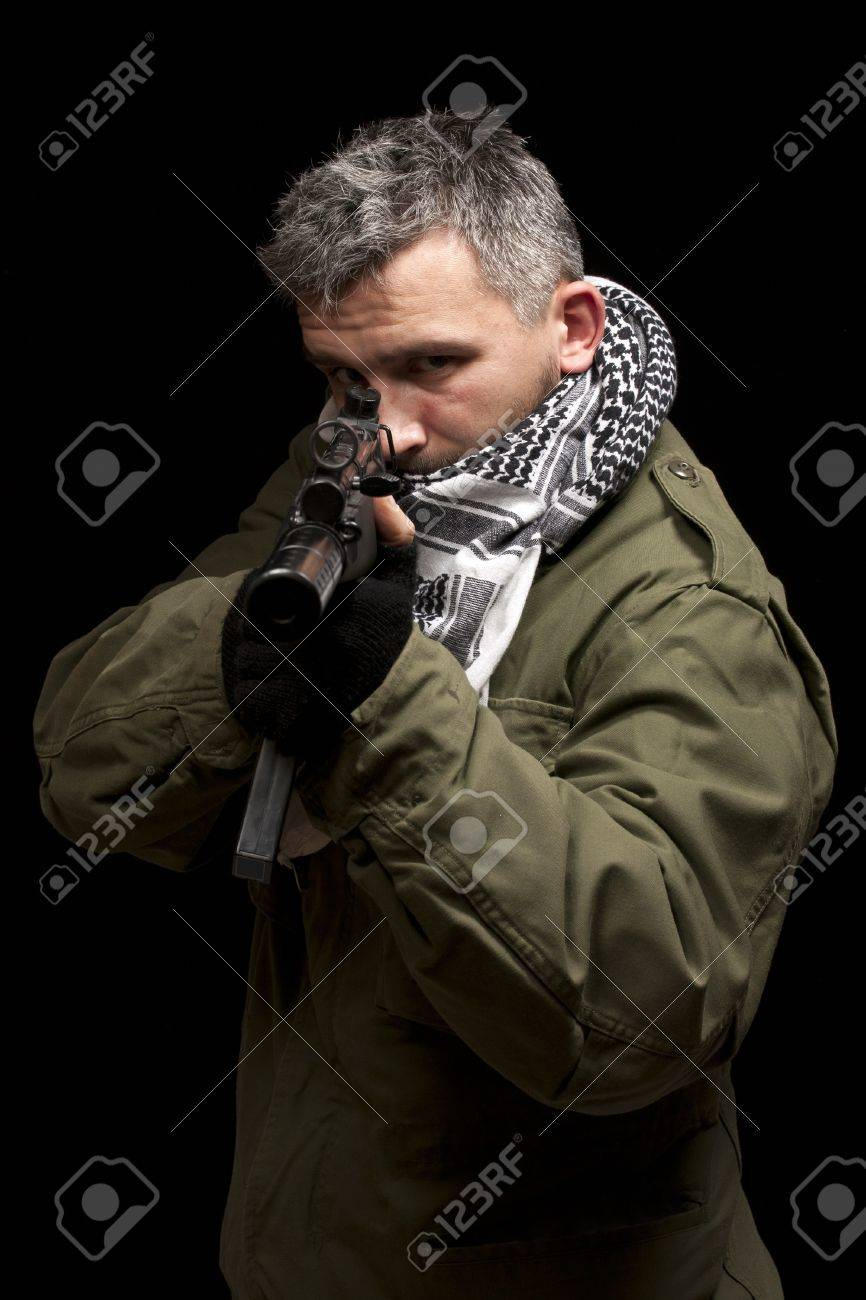 Terrorist in shemagh whit gun, isolated in black background Stock Photo - 9024685