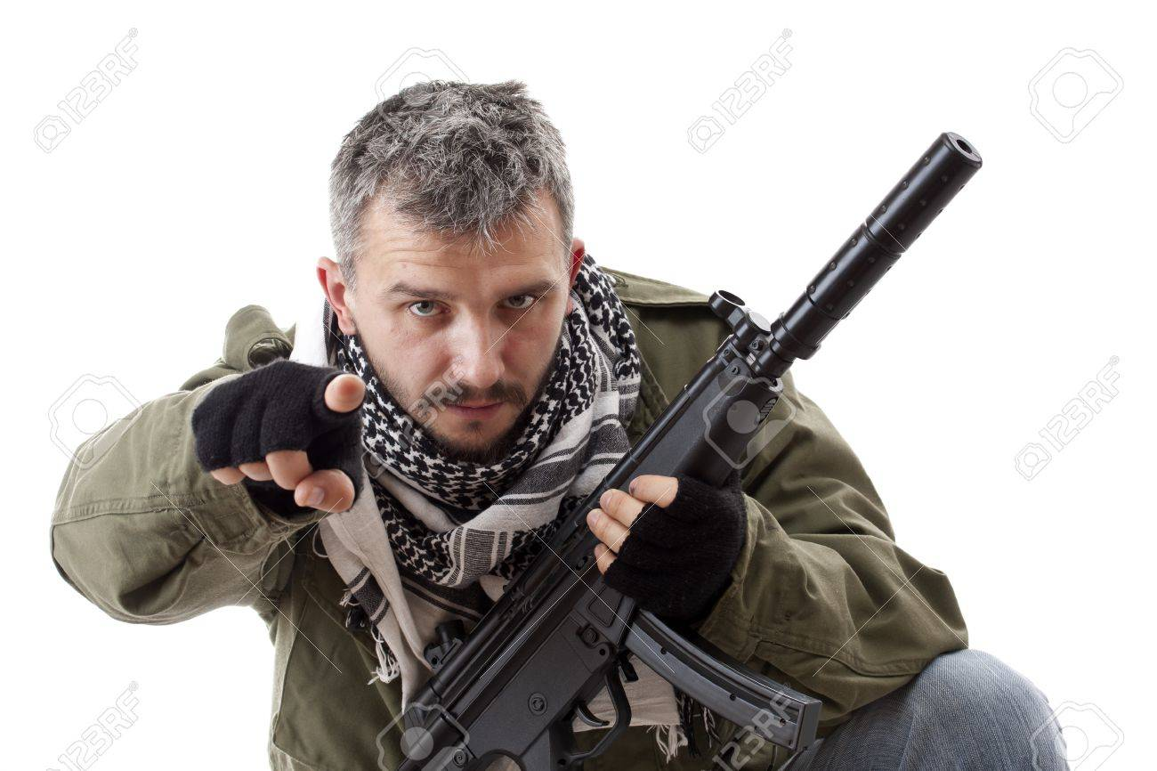 Terrorist with rifle pointing his finger for you, isolated on white background Stock Photo - 9024810