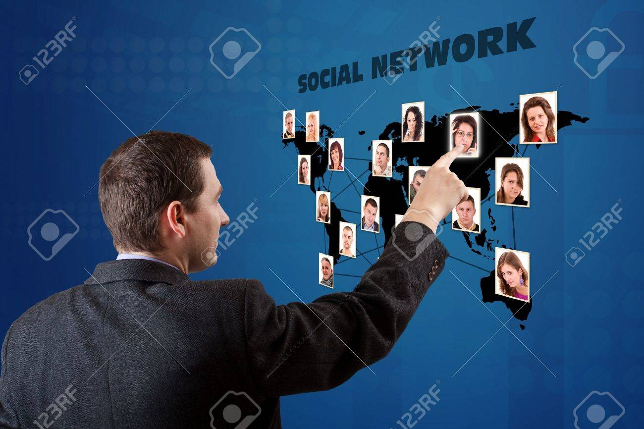 business man pressing a social network map Stock Photo - 9295503