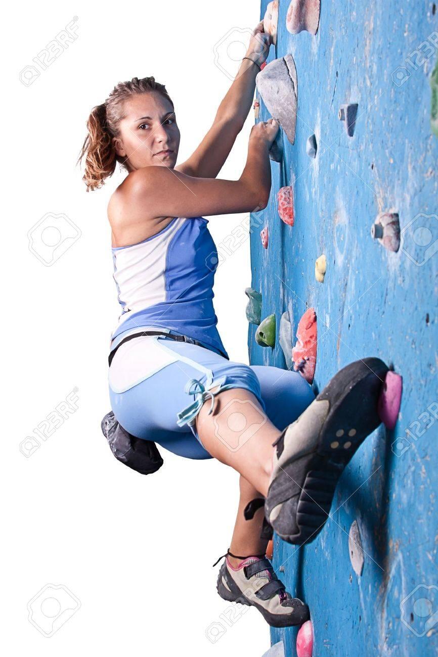 Athletic girl climbing on an indoor rock-climbing wall Stock Photo - 10501753
