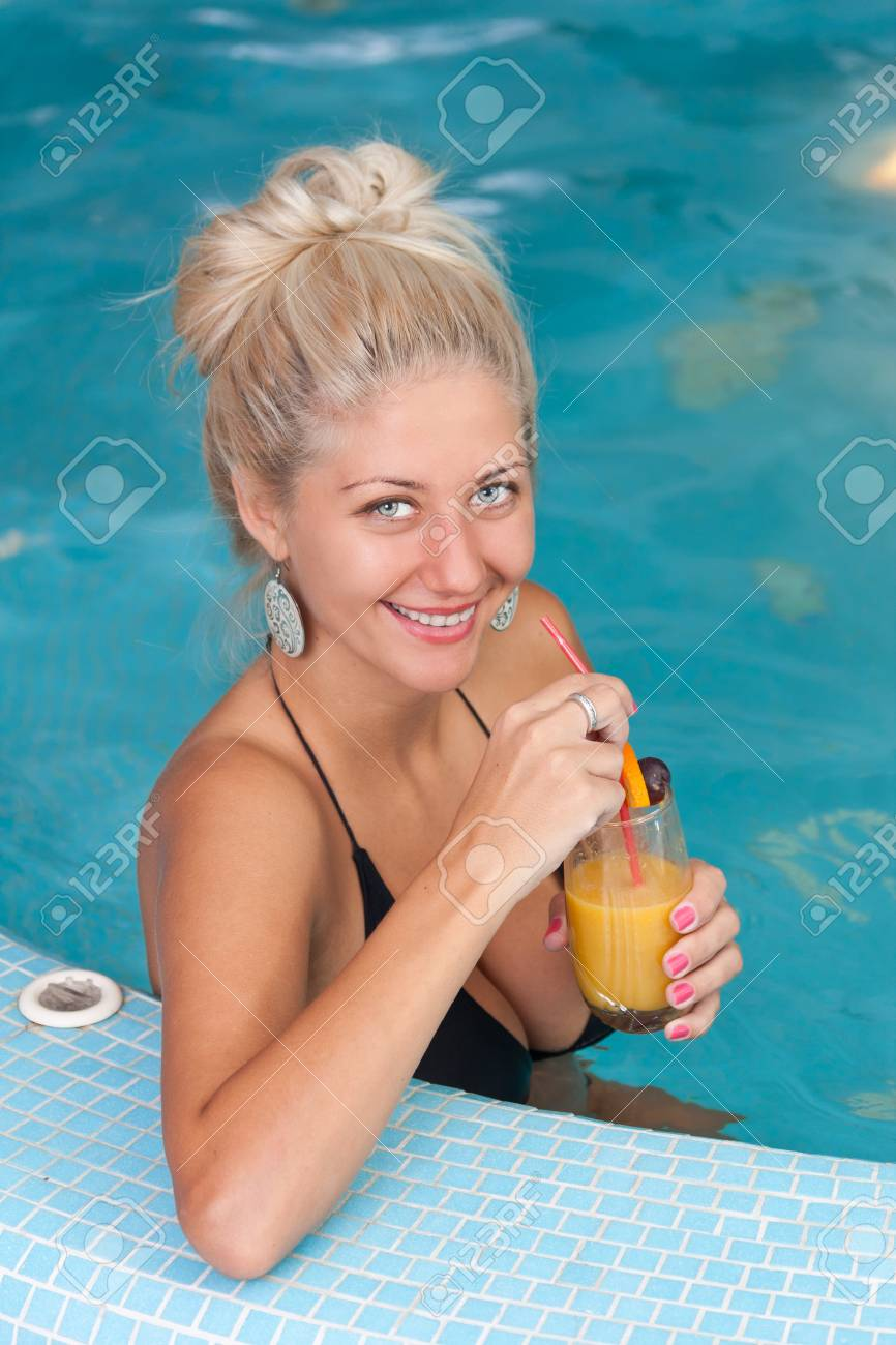 Young beautiful woman enjoying vitamin drinks in jacuzzi Stock Photo - 13652960