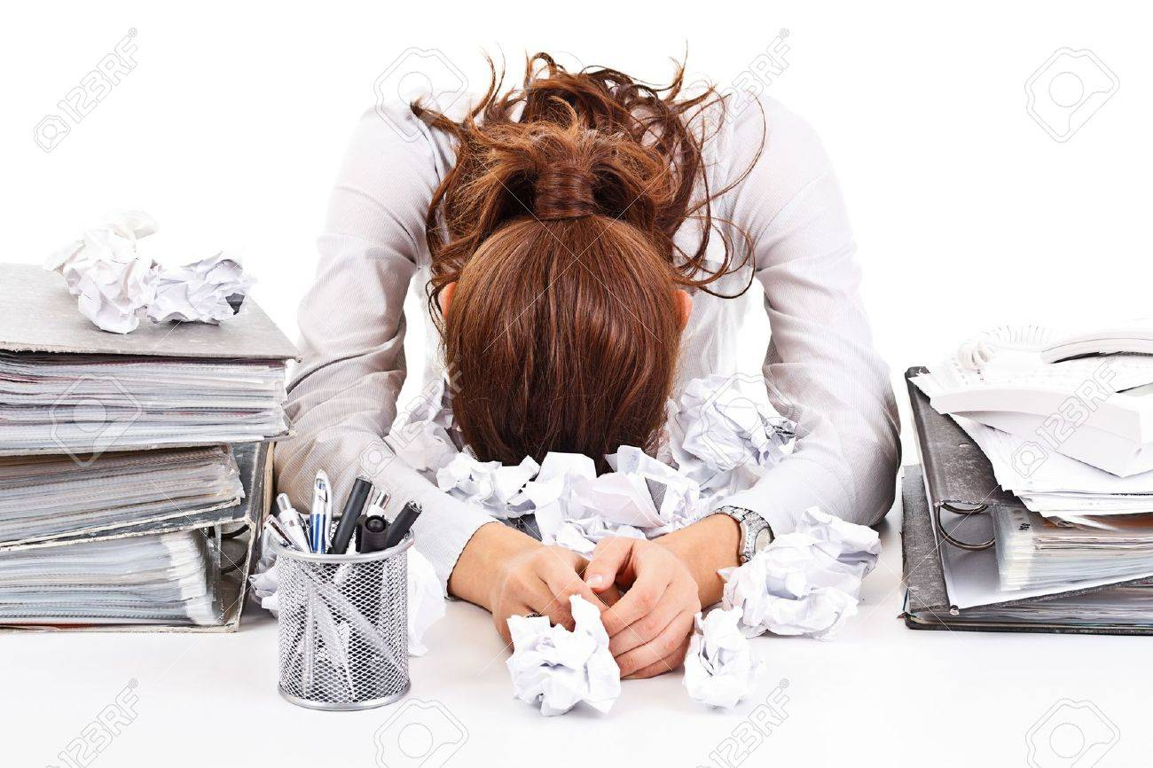 Tired and exhousted business woman with ringbinders - 16216297