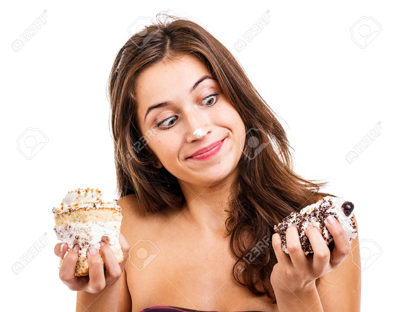 Brunette young girl with two cakes Stock Photo - 16639796