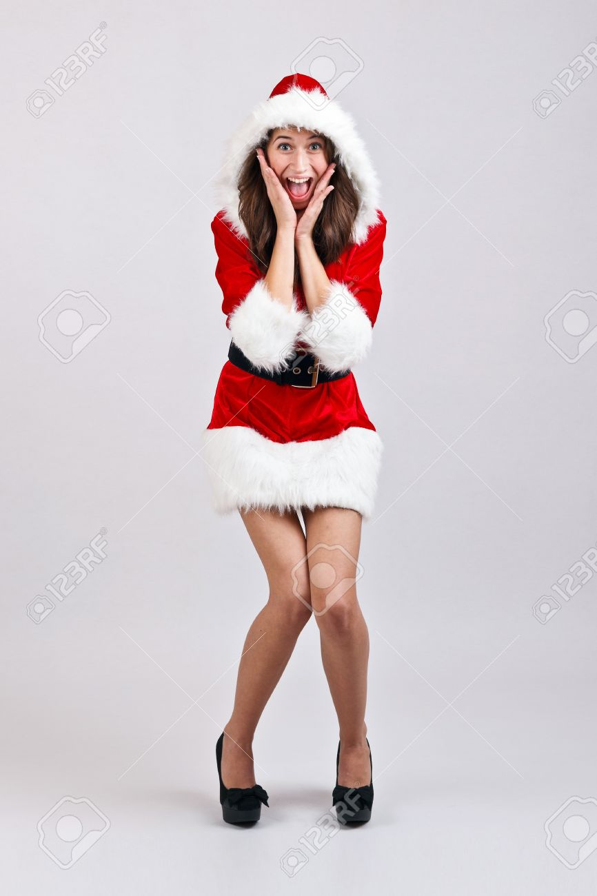 c25ad2438d9aa Christmas girl with red santa dress shocked and surprised