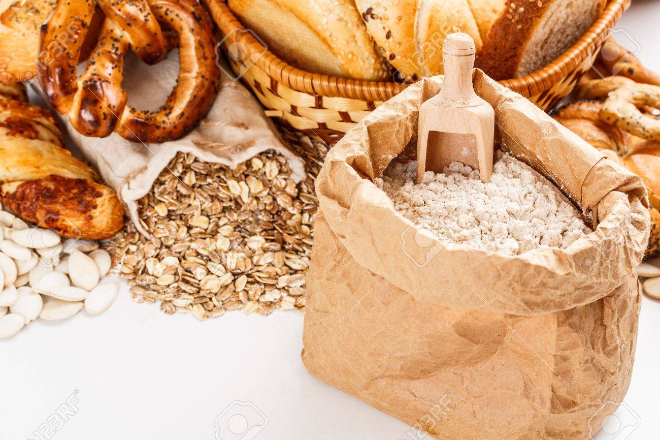 Flour on paper bag and oat flakes spilling from the burlap bag Stock Photo - 17462047
