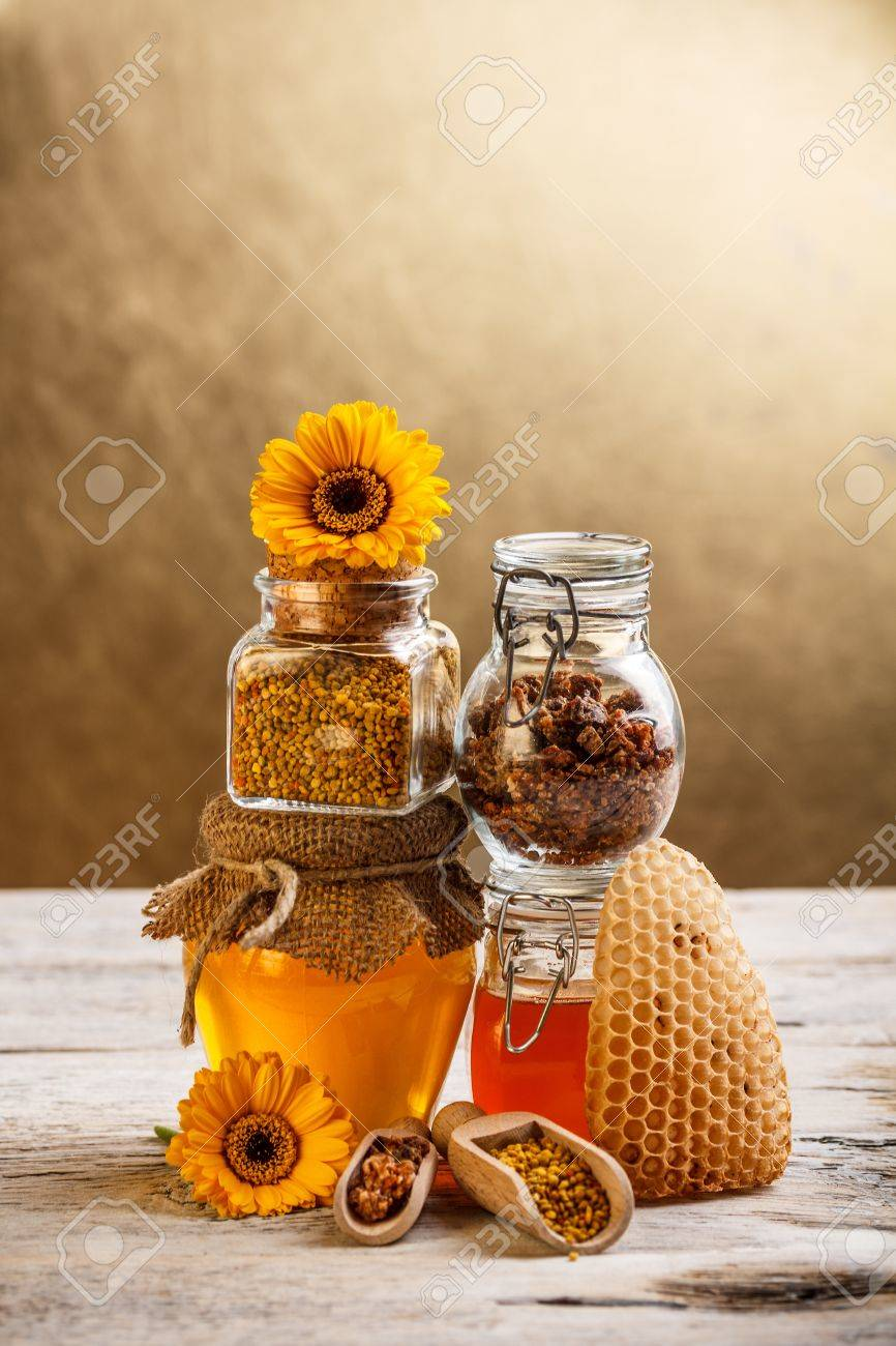 Honeycomb and glass jar of honey, pollen, propolis Stock Photo - 17787659