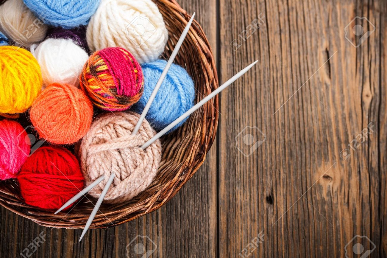 Balls of yarn in a basket with knitting needles - 18862040
