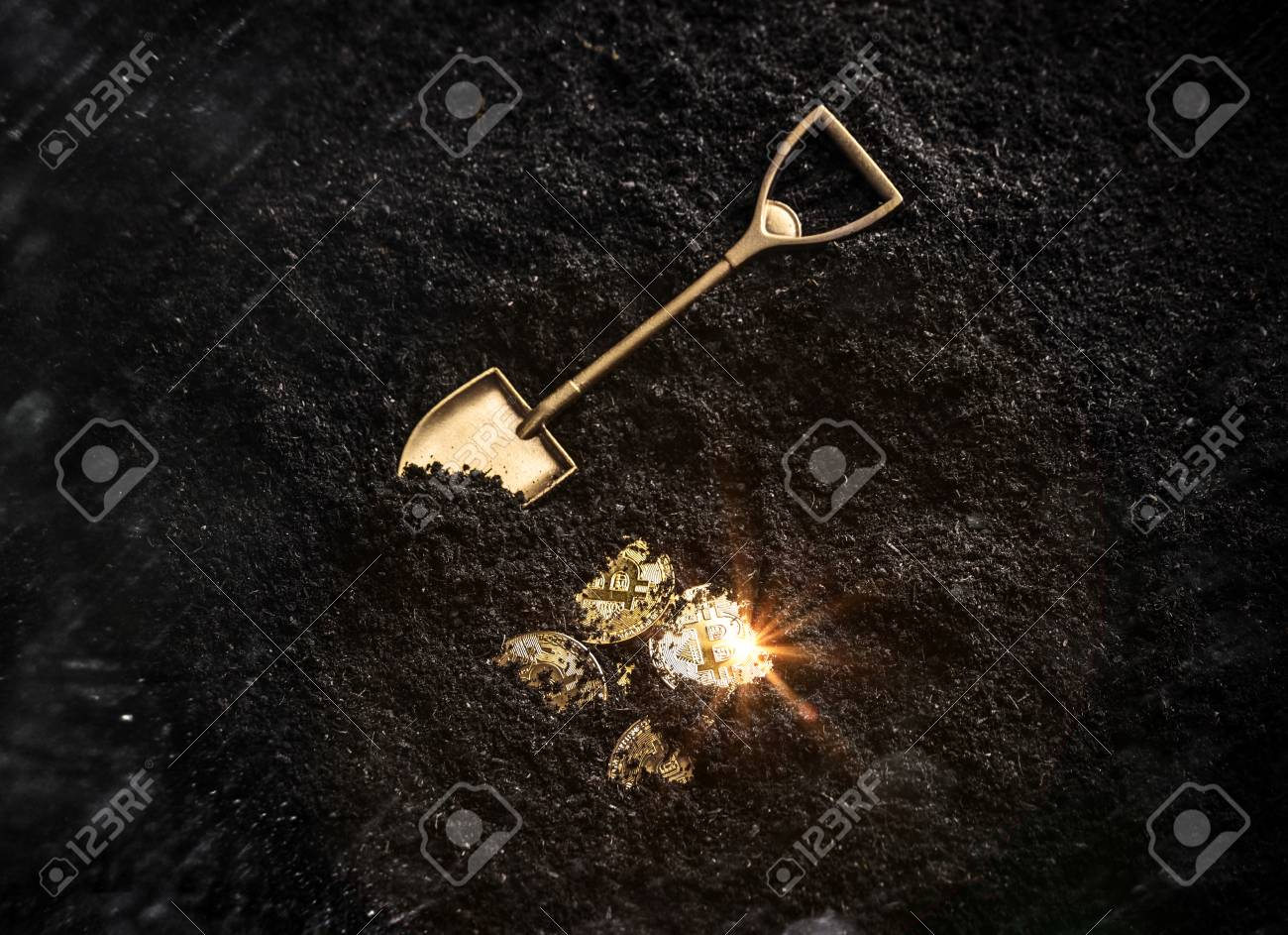 Bitcoin gold coins and shovel gardening tool. Virtual cryptocurrency mining concept. - 104374978