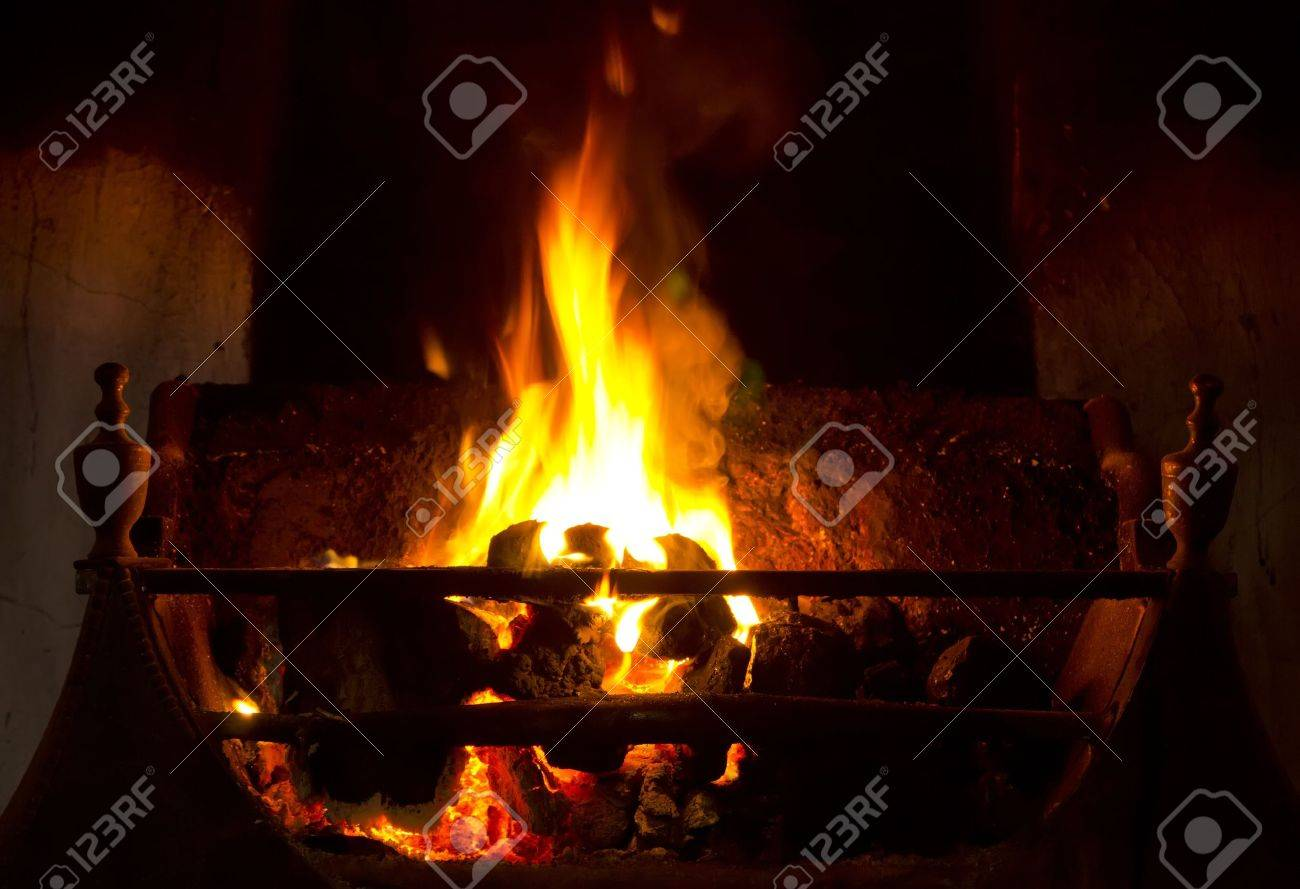 coal fire burning in grate in traditional fireplace stock photo