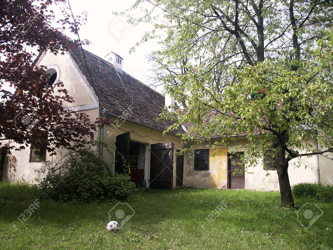 old house backyard and soccer ball on grass stock photo picture