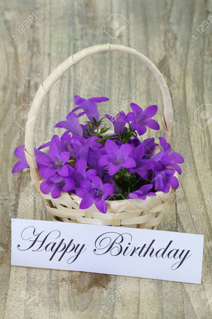 Happy Birthday Card With Campanula Flower Basket Stock Photo