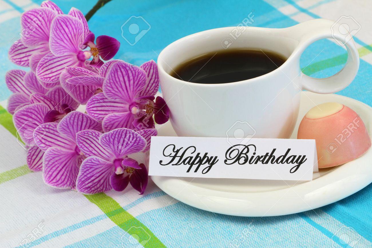 Foto de archivo , Tarjeta del feliz cumpleaños con café, chocolate y rosa  orquídea