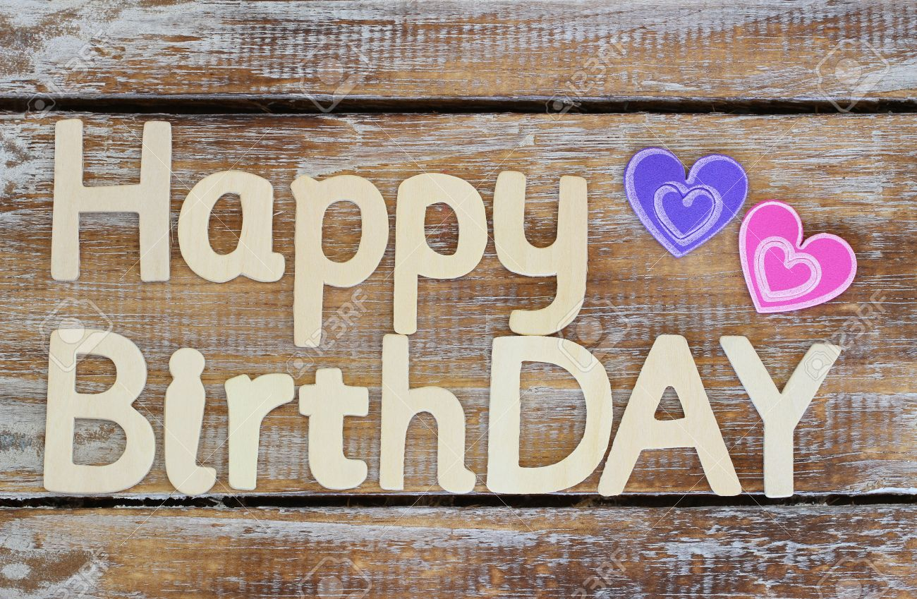 Happy Birthday Written With Wooden Letters On Rustic Wood Stock Photo