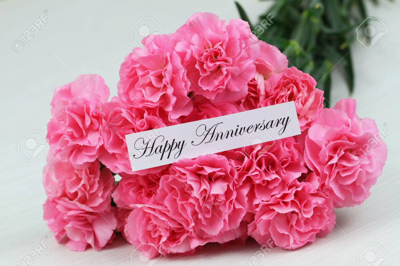 happy anniversary card with pink carnations bouquet on whitewood stock photo 47047295 - Happy Anniversary Cards