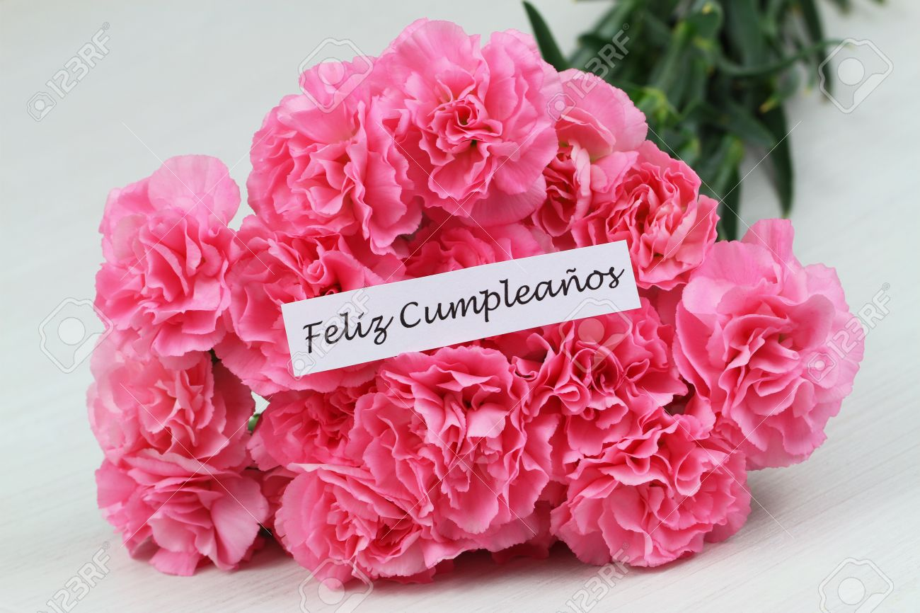 Feliz Cumpleanos Which In Spanish Means Happy Birthday Card With Pink Stock Photo